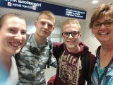 <h5>Suzanne at the airport with French exchange student</h5>