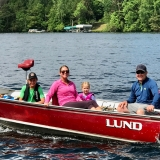 <p>Alicia spends sunny weekends swimming, fishing, and boating with her family at the lake. </p>
