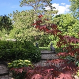 <p>Addy truly has a green thumb and an appreciation for other people's talents. On a recent trip up north, she enjoyed the beauty of her friend's breathtaking garden.</p>