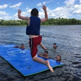 <p>Susan and family enjoy splashing around at the lake.</p>